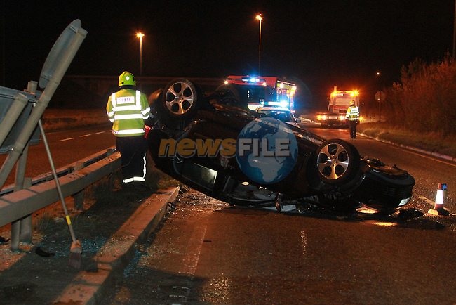 Drogheda Fire service responded to a single vehicle accident on the 27/12/09. The vehicle crashed into the central barrier and fliped over onto the opposite lane. the Driver was removed to Hospital in Drogheda..Picture Fran Caffrey/newsfile.ie..