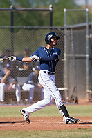 San Diego Padres second baseman Justin Lopez (50) follows through on his swing during an Instructional League game against the Milwaukee Brewers on September 27, 2017 at Peoria Sports Complex in Peoria, Arizona. (Zachary Lucy/Four Seam Images)