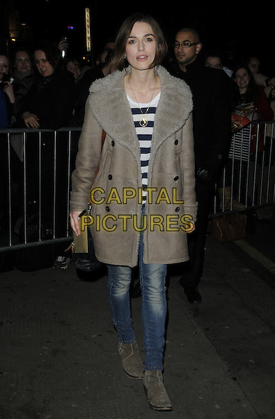 """KEIRA KNIGHTLEY .Leaving after the evening performance of """"The Children's Hour"""", The Comedy Theatre, London, England, UK, February 4th 2011..full length brown grey gray sheepskin fur collar coat jeans ankle boots suede striped top black bag shoulder strap gold necklace .CAP/CAN.©Can Nguyen/Capital Pictures."""