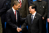Pittsburgh, PA - September 25, 2009 -- United States President Barack Obama, left, greets Hu Jintao, president of China, before a Group of 20 nations family photo on day two of the G-20 summit in Pittsburgh, Pennsylvania, U.S., on Friday, September 25, 2009. G-20 leaders are working on an accord to prevent a repeat of the worst global financial crisis since the Great Depression and ensure a sustained recovery. .Credit: Andrew Harrer / Pool via CNP