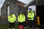 Roz Jewell, Colm McNicholl  and Ross Moodie (centre), part of the HM Coastguard service during a training drill on the the Inner Hebridean island of Colonsay on Scotland's west coast.  The island is in the council area of Argyll and Bute and has an area of 4,074 hectares (15.7 sq mi). Aligned on a south-west to north-east axis, it measures 8 miles (13 km) in length and reaches 3 miles (4.8 km) at its widest point, in 2019 it had a permanent population of 136 adults and children.