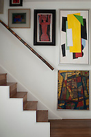 An accomplished artist before turning to fashion, some of Ben de Lisi's own work hangs above the open plan staircase, including his interpretation of a Modigliani