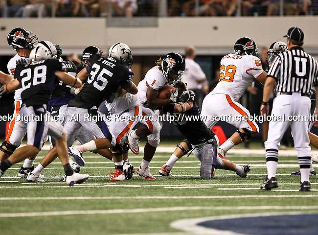 TCU Horned Frogs linebacker Tank Carder #43 tackles Oregon State Beavers running back Jacquizz Rodgers #1 during the game between the Oregon State Beavers and the TCU Horned Frogs at the Cowboy Stadium in Arlington,Texas. TCU defeated Oregon State 30-21.