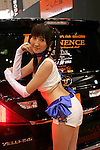 Jan 15, 2010 - Chiba, Japan - Campaign girl of Gonta-Ya company stand beside displayed vehicles during the Tokyo Auto Salon 2010 in Chiba, suburb Tokyo, on January 15, 2010. More than 400 companies, associations and groups are displaying more than 600 custom vehicules in the Japan's biggest tuning show which takes place between January 15 and 17. (Photo Laurent Benchana/Nippon News)