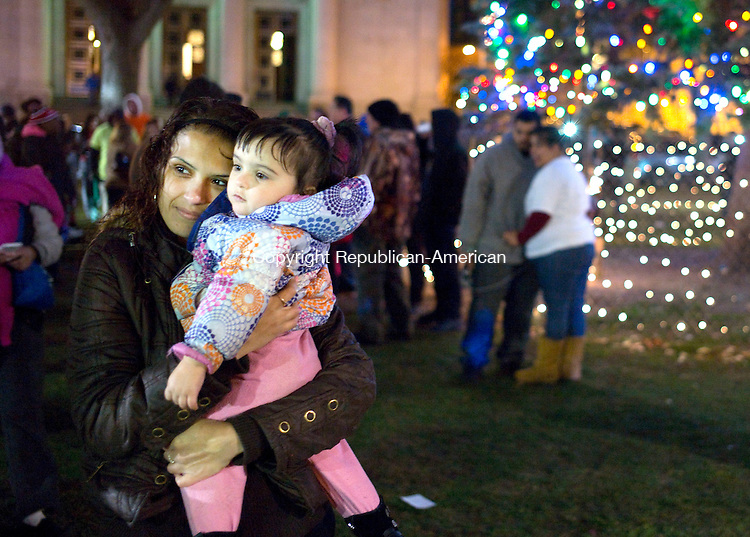 Waterbury, CT- 01 November 2015-112915CM09- Vanessa Alvarado and daughter Sabrina Sepulveda 1 both of Waterbury, have their photograph taken on the Waterbury Green on Sunday night.  The city held it's annual Christmas tree lighting ceremony which featured music, food, parade and horse drawn carriage rides.   Christopher Massa Republican-American