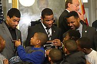 December 22, 2011  (Washington, DC)  IBF/WBA Junior Welterweight Champion Lamont Peterson (center) and his brother Anthony Peterson (left) chat with local children after he was given the key to the city by District of Columbia Mayor Vincent Gray. DC Council Chairman Kwame Brown (right). Peterson won the Title with his win over Amir Khan at the DC Convention Center on December 10, 2011.  Anthony also won his fight on the same night.  (Photo by Don Baxter/Media Images International)