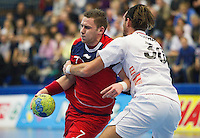 08 JAN 2012 - LONDON, GBR - Great Britain playmaker Chris Mohr (#7, in red) finds his path to goal blocked by Austria's Andreas Lassner (#30, in white) during the men's 2013 World Handball Championships qualification match at the National Sports Centre in Crystal Palace, Great Britain (PHOTO (C) 2012 NIGEL FARROW)