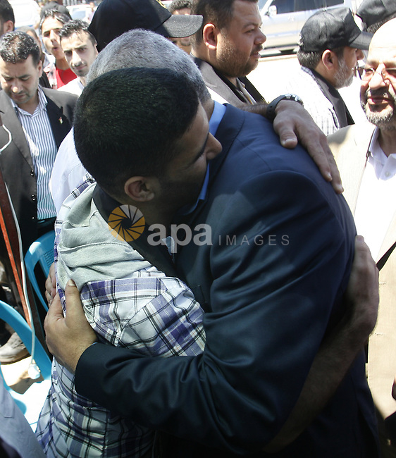 "Palestinian Prime Minister in the Gaza Strip, Ismail Haniyeh meets with Palestinian football player Mahmud Sarsak, who staged a hunger strike of nearly three months while in Israeli jail, in the southern Gaza Strip on July 11, 2012. Sarsak staged a hunger strike of nearly three months to protest his detention without charge under Israel's ""unlawful combatants"" law. His detention order was due to expire or be renewed on August 22. Photo by Eyad Al Baba"