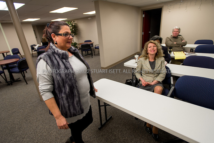 2/13/2013--Bellevue, WA, USA..Natasha Savage at a weekly meeting at the AU Business Club, a small business networking group founded by another Russian immigrant in Bellevue, Olga von Houck (seated right). Many Russian speakers come to type club's events to network...Natasha Savage, whose Armenian Jewish family arrived from Azerbaijan 25 years ago, notes the same sort of insularity among the nearly 100,000 Russian speakers in King County, many of whom live in Kirkland, Redmond, and other Eastside locales....©2013 Stuart Isett. All rights reserved.