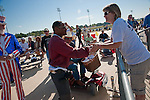 the 950 Radio call in personality A.J. shakes hands with Tea Party patriots at the North Houston Tea Party Rally at Sam Houston Race Park