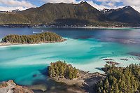Islands in Sitka Sound, infused with Herring spawn resulting in aqua blue colored water, Southeast, Alaska.