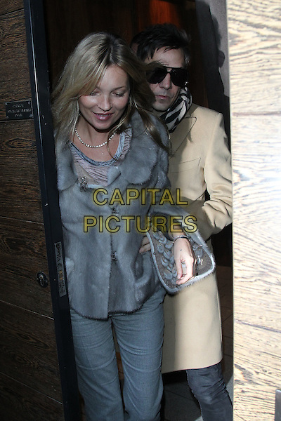 Kate Moss and Jamie Hince visit Umu Japanese Restaurant, London, England..January 16th, 2012.half length grey gray fur jacket beige sunglasses shades married husband wife.CAP/HIL.©John Hillcoat/Capital Pictures .
