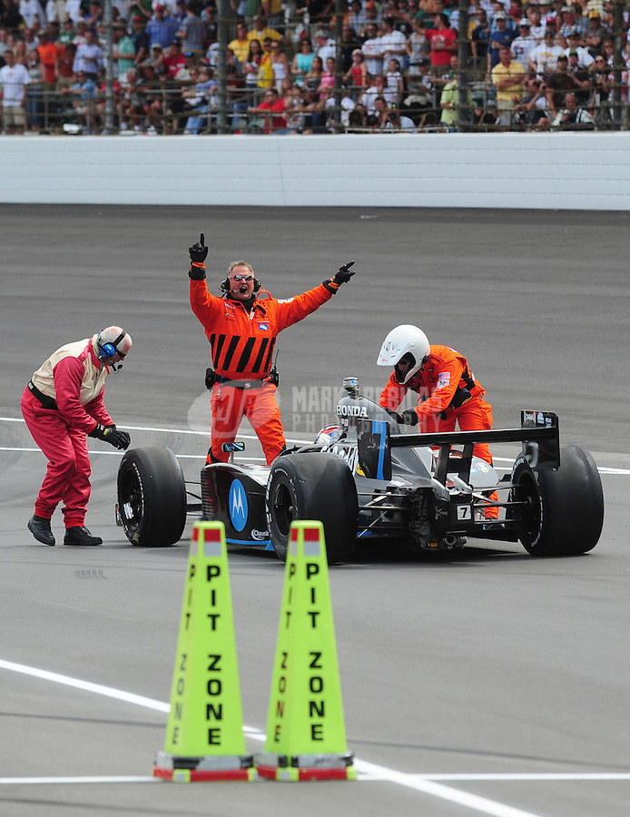 May 25, 2008; Indianapolis, IN, USA; IRL driver Danica Patrick is pushed back pit road after crashing during the 92nd running of the Indianapolis 500 at the Indianapolis Motor Speedway. Mandatory Credit: Mark J. Rebilas-