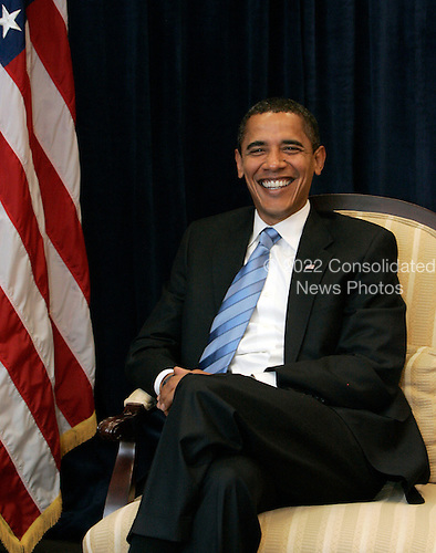 Chicago, IL - November 17, 2008 -- United States President-elect  Barack Obama smiles during a break in a meeting with former Republican presidential candidate United States Senator John McCain (Republican of Arizona), not pictured, United States Senator Lindsey Graham (Republican of South Carolina), not pictured, and Obama's Chief of Staff Rohm Emanuel, not pictured, at Obama's transition office Monday, November 17, 2008, in Chicago, Illinois. .Credit: Frank Polich - Pool via CNP