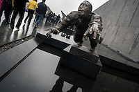 Visitors walk past statues as they enter the Memorial Hall of the Nanjing Massacre in Nanjing, Jiangsu, China on Dec. 13, 2009.  On Dec. 13, 2009, thousands of people visited The Memorial Hall of the Nanjing Massacre in Nanjing, Jiangsu, China, to remember those who died at the hands of Japanese soldiers in 1937-8.  The day marked the 72nd anniversary of the start of the massacre. The historical account has always been mired in controversy, and differing opinions on what actually happened have been a consistent obstacle to relations between China and Japan.  China's official account of history states that 300,000 people were killed by Japanese forces over a 6-week period starting Dec. 13, 1937