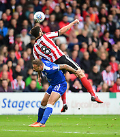 Chesterfield's Ian Evatt is fouled by Lincoln City's Ollie Palmer<br /> <br /> Photographer Chris Vaughan/CameraSport<br /> <br /> The EFL Sky Bet League Two - Lincoln City v Chesterfield - Saturday 7th October 2017 - Sincil Bank - Lincoln<br /> <br /> World Copyright &copy; 2017 CameraSport. All rights reserved. 43 Linden Ave. Countesthorpe. Leicester. England. LE8 5PG - Tel: +44 (0) 116 277 4147 - admin@camerasport.com - www.camerasport.com