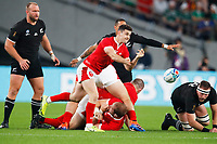 1st November 2019, Tokyo, Japan;  Tomos Williams (WAL) plays the ball along his line;  2019 Rugby World Cup 3rd place match between New Zealand 40-17 Wales at Tokyo Stadium in Tokyo, Japan.  - Editorial Use