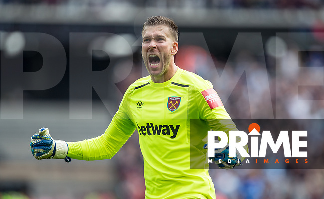 West Ham goalkeeper Adrian celebrates his teams goal 1-0 during the Premier League match between West Ham United and Everton at the Olympic Park, London, England on 13 May 2018. Photo by Andy Rowland / PRiME Media Images.