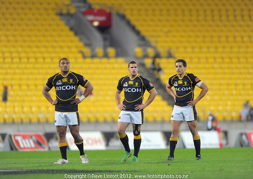 Lima Sopoaga, Shaun Treeby and Tim Bateman waits for a set-piece during the ITM Cup rugby union match between Wellington Lions and North Harbour at Westpac Stadium, Wellington, New Zealand on Saturday, 29 September 2012. Photo: Dave Lintott / lintottphoto.co.nz