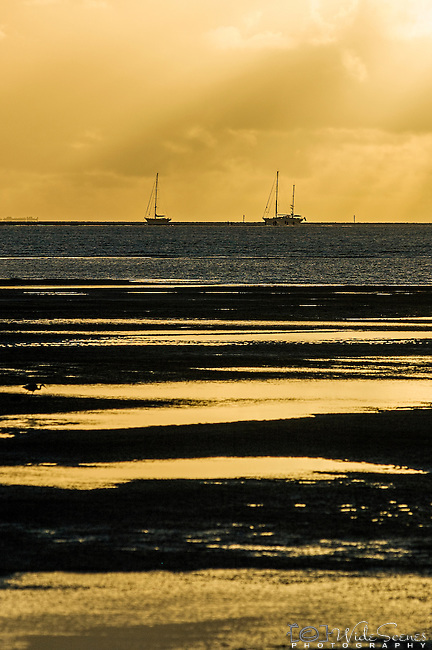 Yachts on the horizon at sunset in Nadi Bay, Fiji Islands