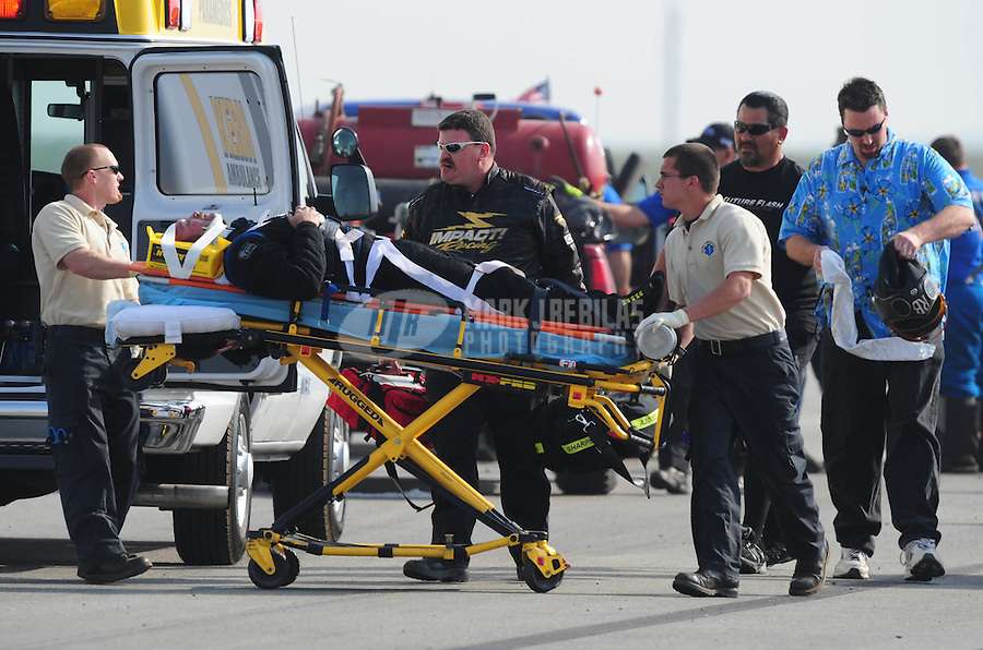Mar. 7, 2008; Bakersfield, CA, USA; Rescue personnel transport nostalgia top fuel driver Randy Beck to an ambulance after he crashed during qualifying for the 50th annual March Meet at the Auto Club Famoso Raceway. Mandatory Credit: Mark J. Rebilas-US PRESSWIRE