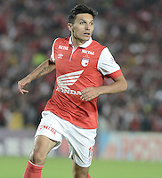BOGOTÁ -COLOMBIA, 24-01-2014. Daniel Torres jugador de Santa Fe en acción durante el encuentro entre Independiente Santa Fe e Itaguí por la fecha 1 Liga Postobón  I 2014 disputado en el estadio el Campín de la ciudad de Bogotá./ Daniel Torres player of Santa Fe in action during the match between Independiente Santa Fe and Itagui for the first date for the Postobon  League I 2014 played at El Campin stadium in Bogotá city. Photo: VizzorImage/ Gabriel Aponte / Staff