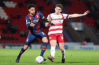 Tim Dieng of Bradford City and Jordan Houghton of Doncaster Rovers during the Sky Bet League 1 match between Doncaster Rovers and Bradford City at the Keepmoat Stadium, Doncaster, England on 19 March 2018. Photo by Thomas Gadd.