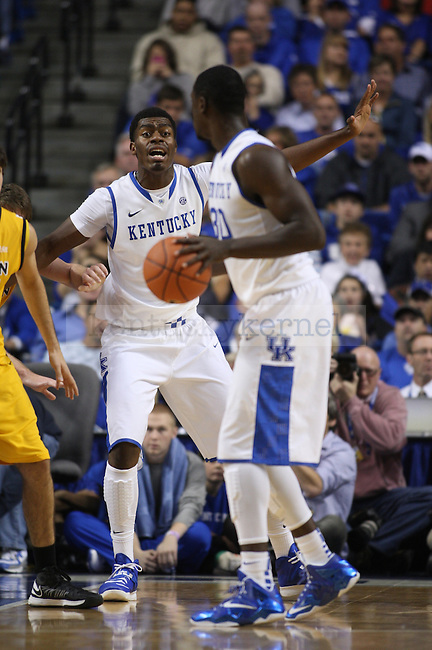 UK center Dakari Johnson (44) tries to get Julius Randle's attention during the first half of the UK vs NKU men's basketball game in Rupp Arena in Lexington, Ky., on Sunday, November 10, 2013. UK leads NKU 48 - 22. Photo by Eleanor Hasken | Staff