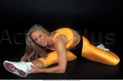 Woman stretching, Model released fitness, 911201. Photo: Mike Hewitt/Action Plus...1991.women young health gym.Stretches stretching stretch out flexability flexion warm up warming up leisure