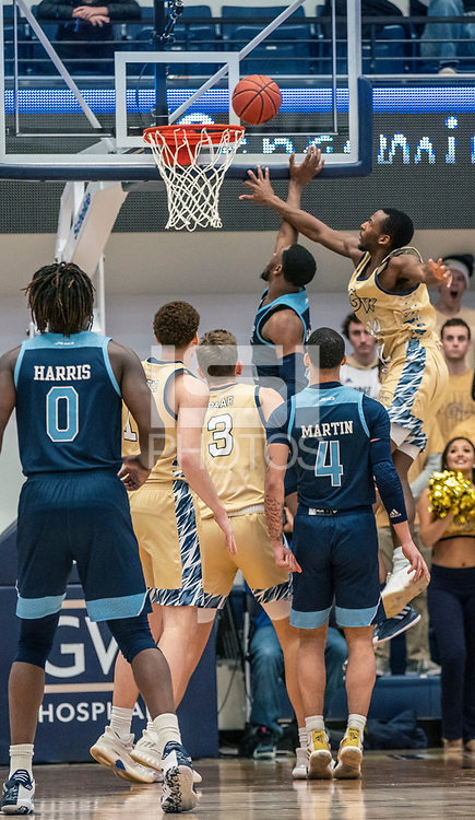 WASHINGTON, DC - FEBRUARY 8: Maceo Jack #14 of George Washington and Cyril Langevine #10 of Rhode Island clash under the basket during a game between Rhode Island and George Washington at Charles E Smith Center on February 8, 2020 in Washington, DC.