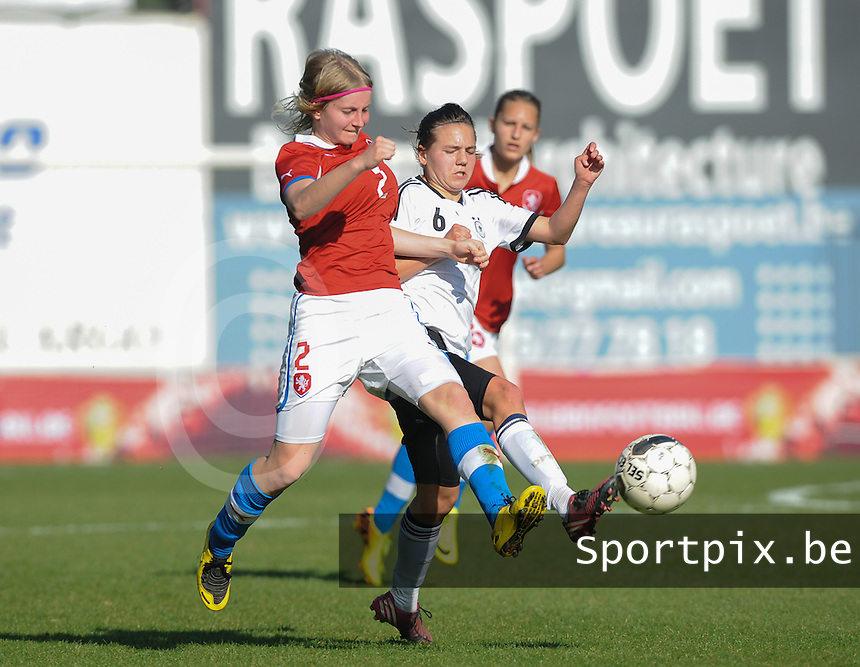 Germany U19 - Czech Republic U19 : <br /> Duel pictured between German Rieke Dieckmann (R) and Czech Republican Lucie Bazoutova (L), during the female soccer match between German U19 and Czech Republic U19, in the first game of the elite round Group 4 in the Uefa European Women's Under 19 competition 2014 in the Edmond Machtens stadion in Brussels. <br /> foto Dirk Vuylsteke / Nikonpro.be