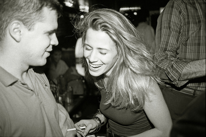 Young couple in a bar in New York, laughing. 1989.