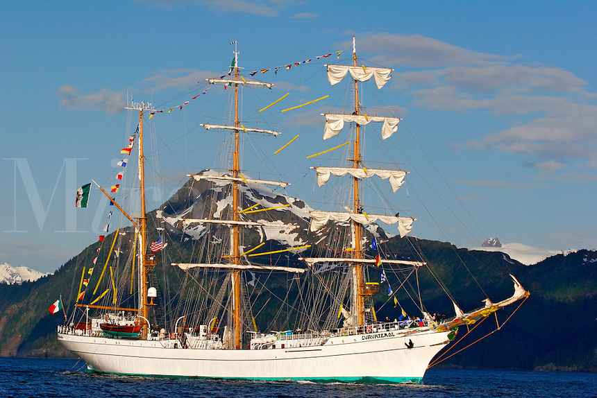 The Mexican Navy tall sailing ship Cuauhtemoc entering Resurrection Bay with Kenai Fjords National Park in the background, Alaska