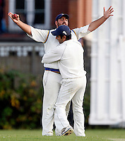 J Azar (arms outstretched) is congratulated by S Shah after taking a catch to dismiss F Frazer during the Middlesex County League Division three game between Wembley and North London at Vale Farm, Wembley on Sat August 6, 2011