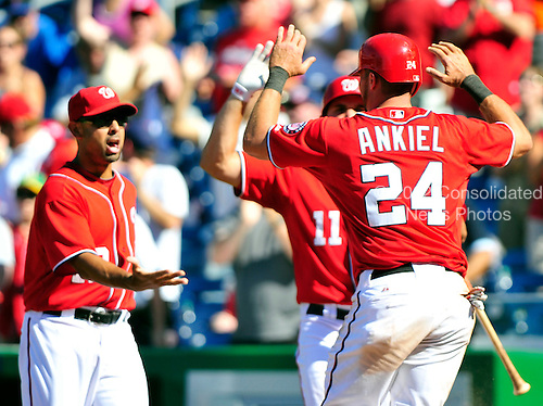 Washington Nationals center fielder Rick Ankiel (24) celebrates with his teammates after scoring the winning run in the bottom of the ninth inning against the New York Mets at Nationals Park in Washington, D.C. on Sunday, July 31, 2011.  The Nationals won the game 3 - 2..Credit: Ron Sachs / CNP.(RESTRICTION: NO New York or New Jersey Newspapers or newspapers within a 75 mile radius of New York City)