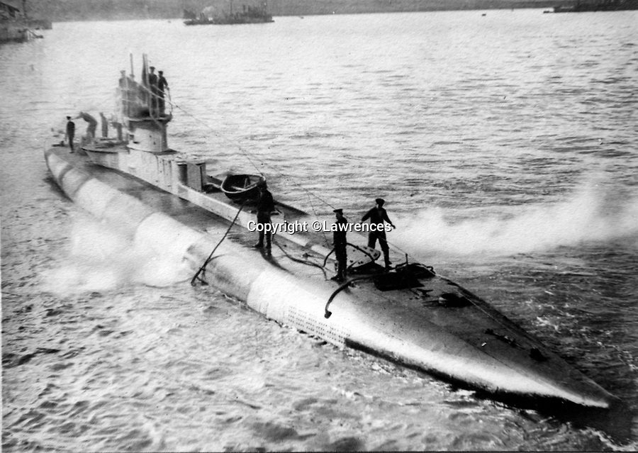 BNPS.co.uk (01202 558833)<br /> Pic Lawrences/BNPS<br /> <br /> G 13 Scapa Flow<br /> <br /> Fascinating early photos of submarine warfare featuring close quarters views of German battleships have come to light 100 years later.<br /> <br /> The photo albums were collated by British Commander Maurice Bailward who documented every stage of his naval career.<br /> <br /> Cmdr Bailward attended Royal Naval College in Osborne, Isle of Wight, from 1906 and 1908, the same time as Edward, the Prince of Wales.<br /> <br /> He was involved in many of the major sea battles of World War Two as well as the British effort to help the Whites during the Russian Civil War of 1919.<br /> <br /> The albums have emerged for sale at auction from a family descendant with Lawrences Auctioneers, of Crewkerne, Somerset.