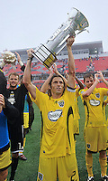 Frankie Hejduk (2) holds up the Inaugural Trillium Cup and proudly displays it to the Columbus fans in attendance. The Columbus Crew won the series at  BMO Field on Saturday September 13, 2008. .The game ended in a 1-1 draw.