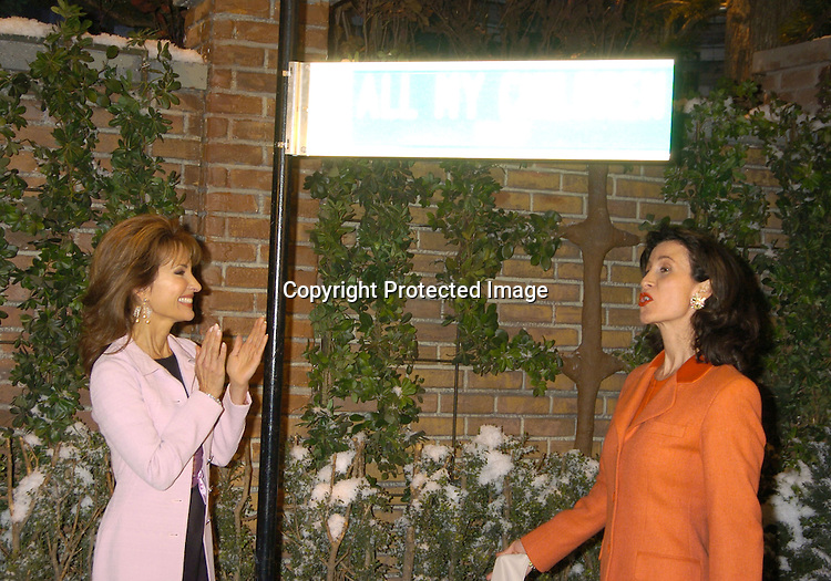 "Susan Lucci and Katherine Oliver ..at the All My Children set to unveil the ""All My Children Way"" street sign in celebration of the 35th Anniversary of the show. Katherine Oliver, Commissioner of the Mayor's Office of Film, Theatre and Broadcasting presented the ..sign. ..Photo by Robin Platzer, Twin Images"