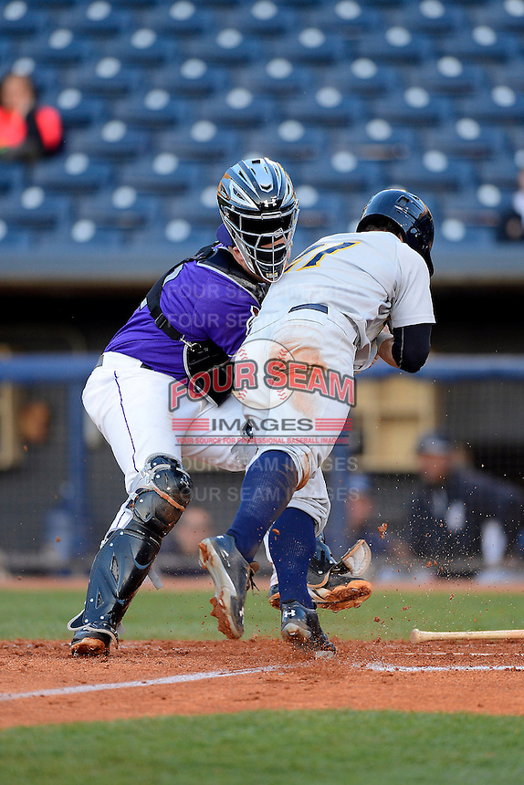 Akron Aeros catcher Chris Wallace #12 blocks the plate tagging out Tyler Austin #21 trying to score during a game against the Trenton Thunder on April 22, 2013 at Canal Park in Akron, Ohio.  Trenton defeated Akron 13-8.  (Mike Janes/Four Seam Images)