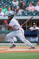 Brian Goodwin (15) of the Syracuse Chiefs follows through on his swing against the Charlotte Knights at BB&T BallPark on June 1, 2016 in Charlotte, North Carolina.  The Knights defeated the Chiefs 5-3.  (Brian Westerholt/Four Seam Images)