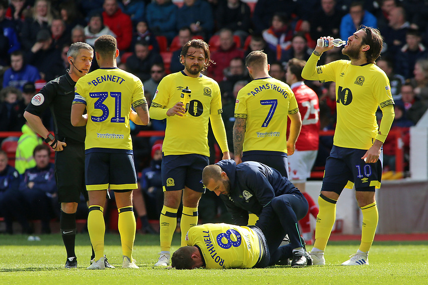 The Blackburn Rovers players take a break as Joe Rothwell goes down injured<br /> <br /> Photographer David Shipman/CameraSport<br /> <br /> The EFL Sky Bet Championship - Nottingham Forest v Blackburn Rovers - Saturday 13th April 2019 - The City Ground - Nottingham<br /> <br /> World Copyright © 2019 CameraSport. All rights reserved. 43 Linden Ave. Countesthorpe. Leicester. England. LE8 5PG - Tel: +44 (0) 116 277 4147 - admin@camerasport.com - www.camerasport.com