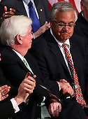 United States Representative Barney Frank (D-MA) (R) and U.S. Senator Chris Dodd (D-CT) (L) shake hands after being thanked by U.S. President Barack Obama before he signed the Dodd-Frank Wall Street Reform and Consumer Protection Act at the Ronald Reagan Building, Wednesday, July 21, 2010 in Washington, DC. The bill is the strongest financial reform legislation since the Great Depression and also creates a consumer protection bureau that oversees banks on mortgage lending and credit card practices. .Credit: Win McNamee - Pool via CNP