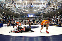 STATE COLLEGE, PA - FEBRUARY 16: The Oklahoma State Cowboys warm-up before a match against the Penn State Nittany Lions on February 16, 2014 at Rec Hall on the campus of Penn State University in State College, Pennsylvania. Penn State won 23-12. (Photo by Hunter Martin/Getty Images) *** Local Caption ***