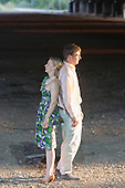 "Dinslaken, Germany. 12 August 2015. Sandra Hüller as Magdalena and Steven Scharf as Accattone. Performance of the Pier Paolo Pasolini play ""Accattone"" at Ruhrtriennale festival of the arts at Kohlenmischhalle of Schacht Lohberg in Dinslaken, North Rhine-Westphalia, Germany. Accattone is directed by festival director Johan Simons with music by Johann Sebastian Bach conducted by Philippe Herreweghe. With Steven Scharf as Accattone."