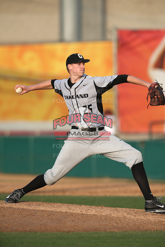Tyler Palm (25) of the Oakland Grizzlies pitches during a game against the Southern California Trojans at Dedeaux Field on February 21, 2015 in Los Angeles, California. Southern California defeated Oakland, 11-1. (Larry Goren/Four Seam Images)