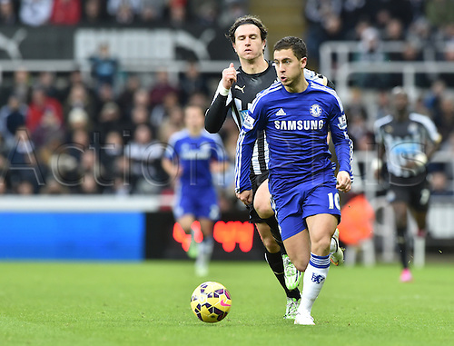 06.12.2014.  Newcastle, England. Premier League. Newcastle United versus Chelsea. Eden Hazard of Chelsea runs with the ball chased by Daryl Janmaat of Newcastle United
