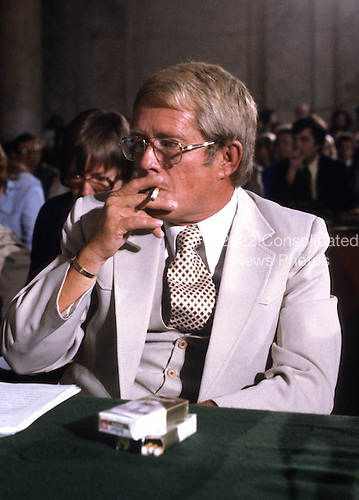 "Billy Carter, brother of United States President Jimmy Carter, smokes a cigarette as he prepares to testify before the U.S. Senate Judiciary Subcommittee hearing ""To Investigate Activities of Individuals Representing Interests of Foreign Governments"", also known as ""Billygate"" on August 21, 1980.  The subcommittee was investigating Mr. Carter's involvement with the Libyan government..Credit: Arnie Sachs / CNP"