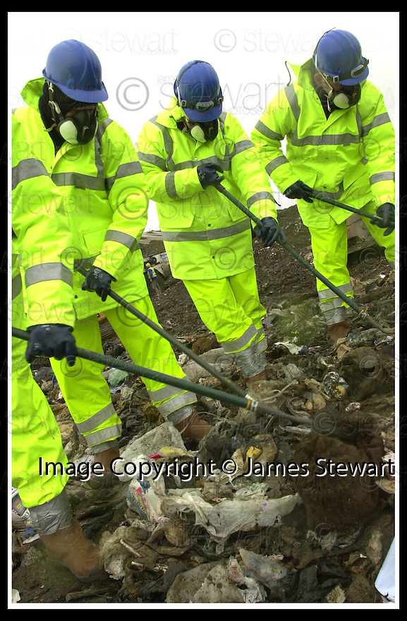 21/02/2002                 Copyright Pic : James Stewart .Ref :     .File Name : stewart-linn landfill 08.CENTRAL SCOTLAND POLICE OFFICERS SEARCH THE AVONDALE LANDFILL SITE FOR CLUES AS TO THE WHEREABOUTS OF MISSING BUSINESS MAN GARY LINN........(see copy from Jim Davis).......James Stewart Photo Agency, Stewart House, Stewart Road, Falkirk. FK2 7AS      Vat Reg No. 607 6932 25.Office     : +44 (0)1324 630007     .Mobile  : + 44 (0)7721 416997.Fax         :  +44 (0)1324 630007.E-mail  :  jim@jspa.co.uk.If you require further information then contact Jim Stewart on any of the numbers above.........