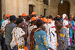 African Christian pilgrims from the Ivory Coast in preparing to walk the Via Dolorosa begin at the Convent of the Sisters of Zion in the Muslim Quarter of the Old City of Jerusalem.  The Old City of Jerusalem and its Walls is a UNESCO World Heritage Site.