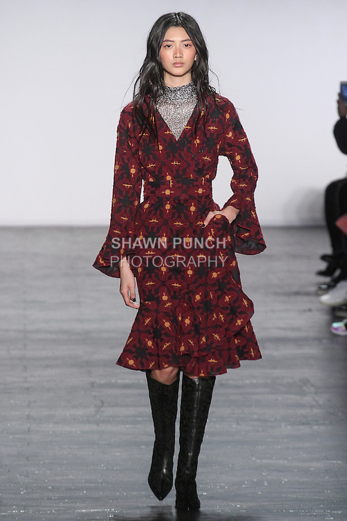 """Model I-Hua walks runway in a knitted lace mock turtleneck in gunmetal, with medallion motif fly away jacquard wrap dress, from the Vivienne Tam Fall Winter 2016 """"Cultural Dreamland The New Silk Road"""" collection, presented at NYFW: The Shows Fall 2016, during New York Fashion Week Fall 2016."""